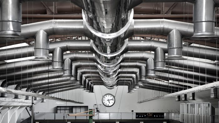 a complex set of ductwork extended from one singular body. the ducts on both sides are parallel